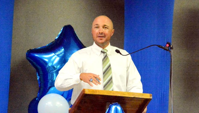 Cavemen baseball coach Cody May speaks at Wednesday's banquet at Leo Sweet Center.