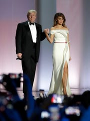 In this Jan. 20, 2017, file photo President Donald Trump arrives with first lady Melania Trump at the Liberty Ball in Washington.