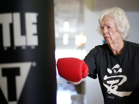 Patricia Sundstrom, 85, punch a heavy bag as she works