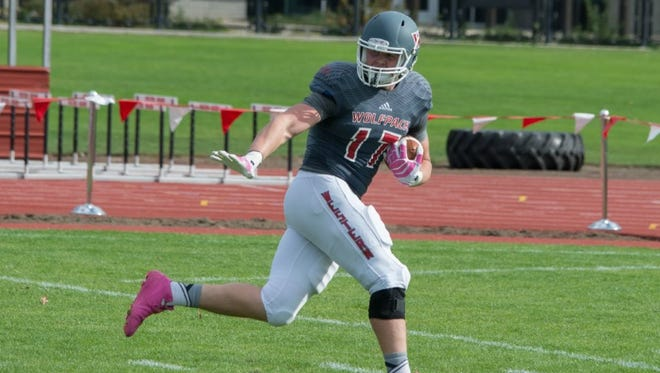 Western Oregon's Andy Avgi is having an impact on the Wolves' football team after a stellar career with the basketball team.