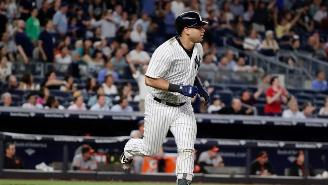 Gary Sanchez begins his trot around the bases after hitting a solo home run against the Orioles on Thursday night.