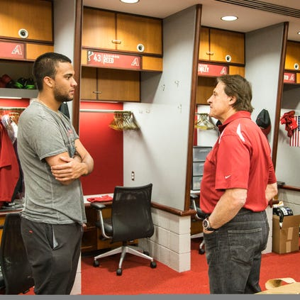 Diamondbacks pitcher Randall Delgado (left) talks with Chief Baseball Officer Tony La Russa on Monday in the team's clubhouse at Chase Field, where players cleaned out their lockers after a 64-98 season.