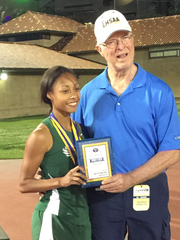 Grace Christian senior Jai Moulden (left) receives the award for Most Outstanding Performer of the Class B girls at the 2016 LHSAA track and field meet. Moulden helped the Lady Warriors win the 2015 girls Class B title.