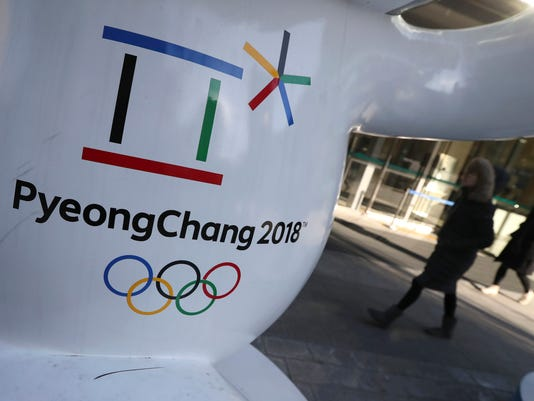 The official emblem of the 2018 Pyeongchang Games is seen in downtown Seoul, South Korea, Thursday, Feb. 1, 2018. In a rare sight, North Korean flags flew in South Korea on Thursday as the South prepared for the Winter Olympics that has brought a temporary lull in tensions surrounding the North's nuclear program. (AP Photo/Lee Jin-man)