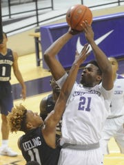 ACU's Jalone Friday (21) shoots as Charleston Southern's Christian Keeling (11) defends. The Buccaneers beat ACU 66-65 in a nonconference game Tuesday, Nov. 22, 2016 at Moody Coliseum.