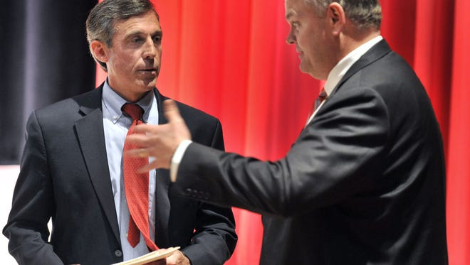 Gubernatorial candidates Democratic Congressman John Carney (left) and Republican state Senator Colin Bonini have a friendly exchange prior to their debate held at Delaware State University Tuesday night.