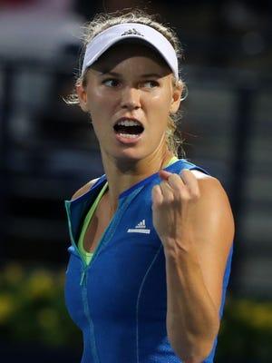 Caroline Wozniacki of Denmark reacts after winning against Anastasija Sevastova of Latvia during their semifinal at the Tennis Championship in Dubai.