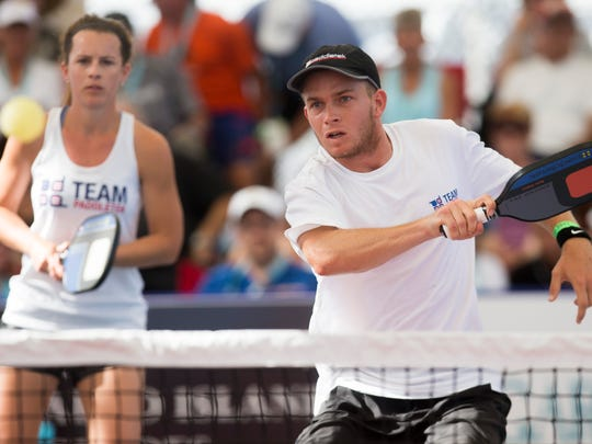 Kyle Yates returns a hit while Sarah Yates plays back during the U.S. Open Pickleball 19-and-over mixed doubles championship match at East Naples Community Park Tuesday, April 25, 2017. The brother and sister Yates dup would go on to win the match.