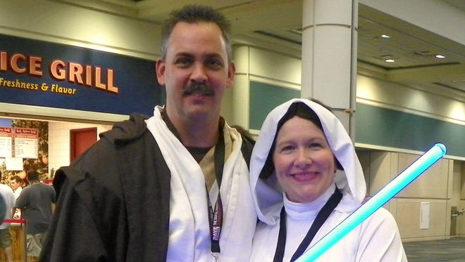 """Luann Manderville and her husband, David, are (can't you tell?) are mega fans of """"Star Wars."""" This was taken at a SW convention, but they have used these costumes on Halloween."""