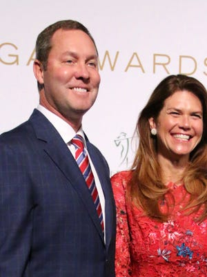 LPGA commissioner Michael Whan and his wife, Meg,  pose for a photo on the green carpet. The LPGA's biggest names line the green carpet at Thursday evening's Rolex LPGA Awards at Tiburón Golf Club in Naples. The Rolex Awards ceremony will air Monday at 8 p.m. on Golf Channel
