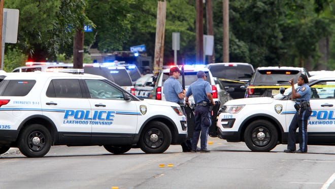 Lakewood police block Route 88 in the township Friday afternoon, July 7, 2017, near the scene of a reported home invasion near Cherry Street.  Route 88 is closed between New Hampshire Avenue and Clover Street.
