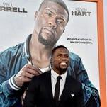 "Kevin Hart frequently jokes about his diminutive stature -- he's 5-foot-4. Well, the poster behind him emphasizes the point as he arrives at the premiere of his new movie ""Get Hard"" March 25 in Los Angeles."