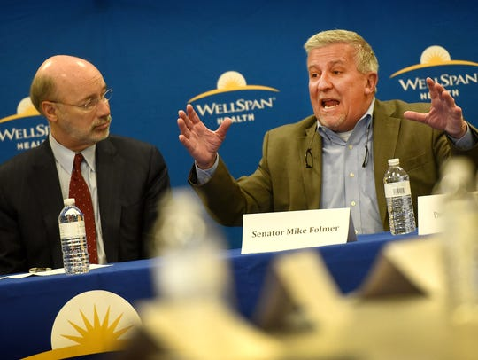 State Sen. Mike Folmer gestures while speaking at a