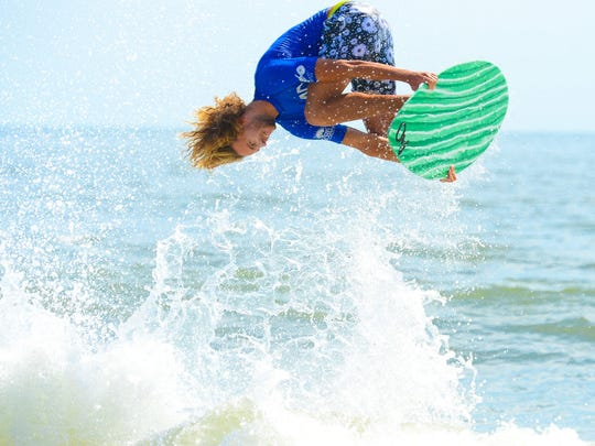Blair Conklin, Laguna Beach, Ca, goes airborne during the Men's Pro Division heat in the semifinals of the Skim USA Association ZAP Pro/Am Skimboarding Competition in Dewey Beach, De. on Friday, August 11, 2017.