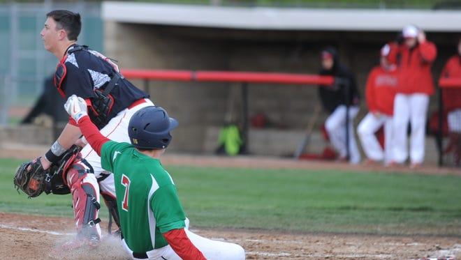 Anderson's Joe Moran (7) slides safely into home place as Richmond catcher John Cheatwood waits on the throw Wednesday at McBride Stadium.