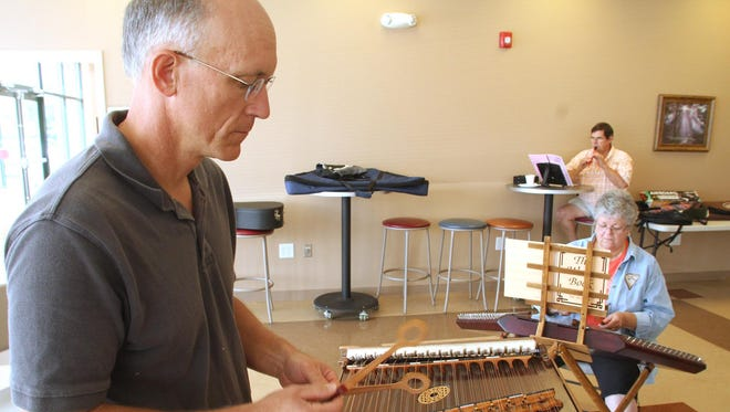 Player Craig Dehmel plays the hammered dulcimer during an all-day jam at the Fowlerville Church of the Nazarene