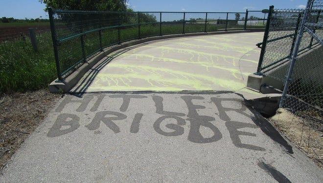 The Ozaukee County Sheriff's Office posted an image of graffiti found on the Ozaukee Interurban Trail bridge that crosses I-43. The graffiti reads 'Hitler Brigde.'
