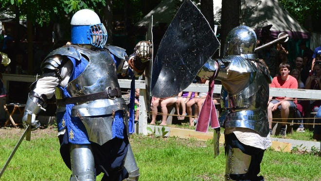 Rob Schipper (left) battles with a fellow member of Her Majesty's Royal Guard at the Black Rock Medieval Festival in Augusta on Saturday, July 7, 2018.