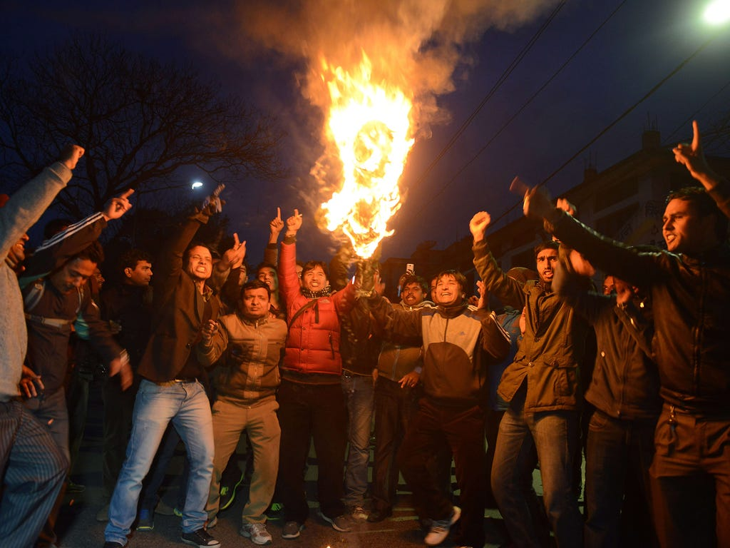 Supporters of a 30-party political alliance led by the Unified Communist Party of Nepal chant slogans as they burn an effigy of Subhas Nembang, chairman of the Constituent Assembly, on Jan. 25 in Kathmandu. Nemnag announced plans to hold a vote to en