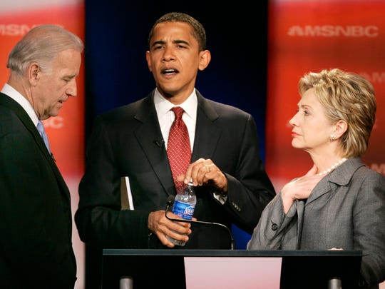 Sen. Joe Biden, D-Del., left, talks with then-Sen. Barack Obama, D-Ill., and then-Sen. Hilary Rodham Clinton, D-N.Y., prior to the start of the Democratic presidential primary debate of the 2008 election.