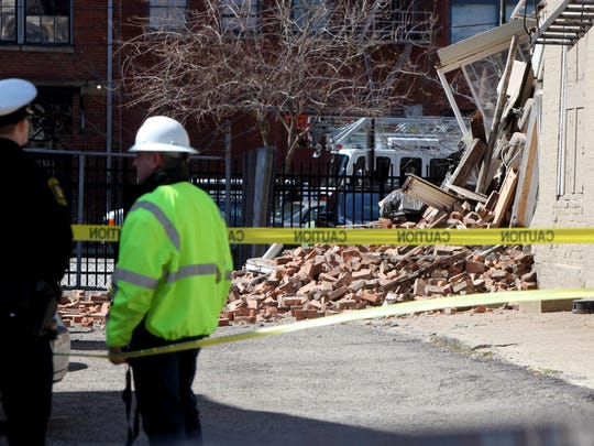 A vacant building at near the corner of Walnut and 13th streets partially collapsed Sunday just after 1 p.m. Cincinnati police reported that no one was injured. Walnut Street was closed for several hours.