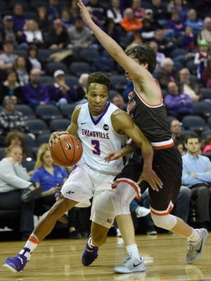 University of Evansville's Jaylon Brown is fouled by Bowling Green's Dylan Frye as he drives a long the baseline during the game at the Ford Center in Evansville Tuesday.