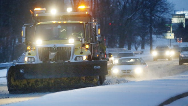 A snowplow cleared sections of U.S. 31 South near the I-465 interchange on Jan. 20, 2016.