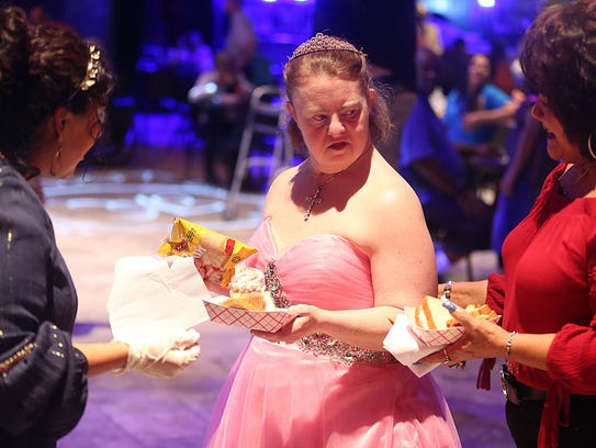 Prom goers grab a bit to eat during MHMR's A Night