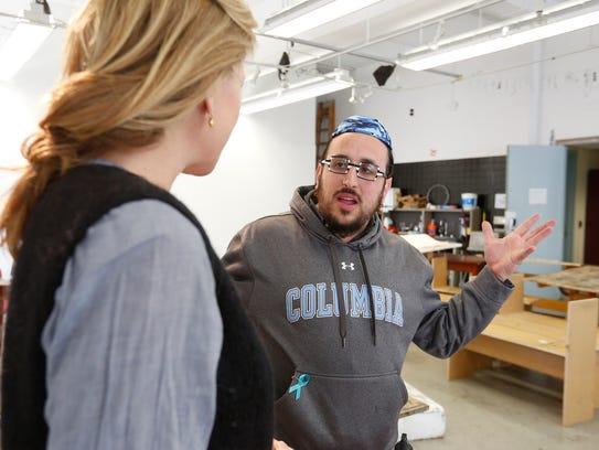 Lipa Schmeltzer talks with his art professor, Celia