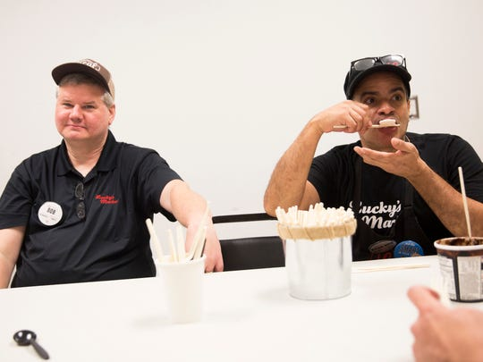 "Produce Manager Bob McLaren, left, and Cheese Specialist Richie Ramirez sample pints of San Bernardo Ice Cream, a regional product made in Miramar, Fla., at Lucky's Market  in East Naples on Tuesday, Aug. 29, 2017. ""I like ice cream that you can actually taste what's in it,"" Ramirez said. ""It doesn't overpower you."""