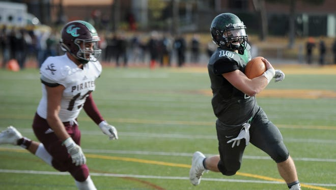 West Deptford quarterback Pete Orio heads toward the end zone for a 3-yard touchdown run in Sunday's win over Cedar Creek.