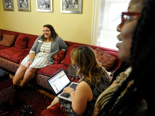 Liv N. Parks, left, talks with students Kait Spear