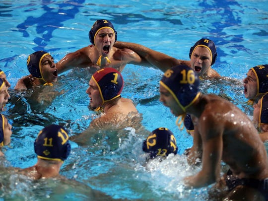 The La Quinta water polo conduct their pregame chant before taking on Palm Desert in the DVL finals on Wednesday at Palm Desert High School. The Blackhawks won 12-8.
