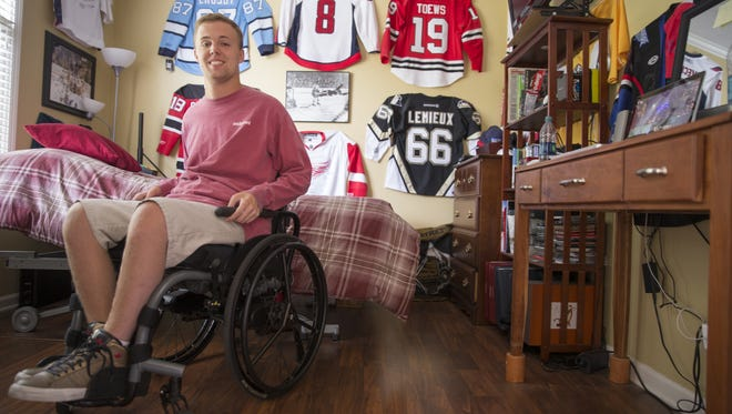 Derek Zike, at his home in Fishers, Monday, Sept. 26, 2016. Zike was paralyzed from a hockey injury when he was 16. He's finishing a master's degree and hopes to finish his Ph.D.