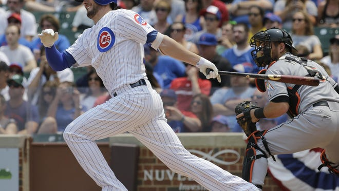 Chicago Cubs' Kris Bryant, left, hits a single during the first inning of a baseball game against the Miami Marlins on Sunday, July 5, 2015, in Chicago. Bryant was named to the National League All-Star team as a rookie.