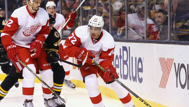 Red Wings forward Andreas Athanasiou skates against the Boston Bruins during the first period at TD Garden on Saturday.