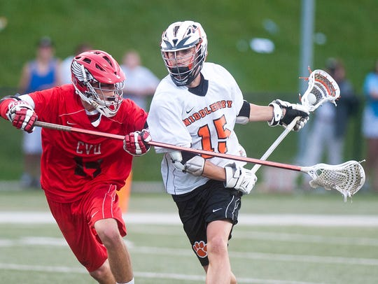 Middlebury's Connor Quinn, right, controls the ball