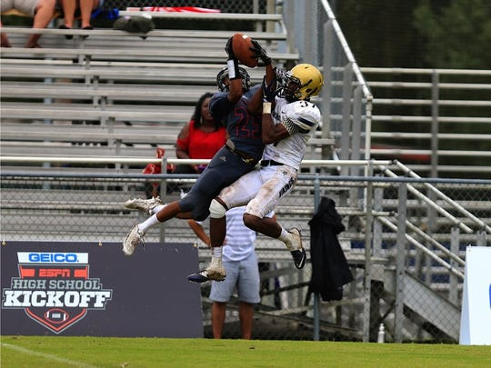 Wakulla's Kelton Donaldson goes up for a catch against a Spartanburg defender on Saturday.