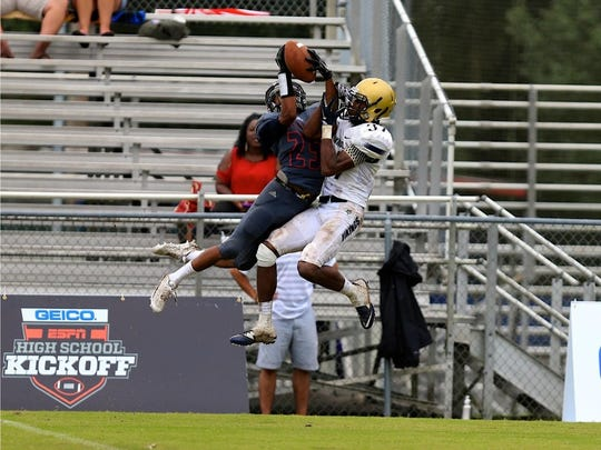 Wakulla receiver Kelton Donaldson makes a catch against a Spartanburg defender during a televised ESPN U game on Aug. 28.