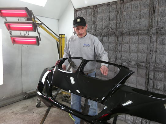 Dennis Malles in his auto-body shop in Montrose on March 12