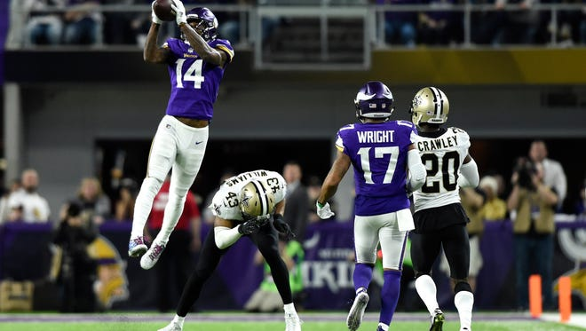 Stefon Diggs #14 of the Minnesota Vikings leaps to catch the ball in the fourth quarter of the NFC Divisional Playoff game against the New Orleans Saints on January 14, 2018 at U.S. Bank Stadium in Minneapolis, Minnesota. Diggs scored a 61-yard touchdown to win the game 29-24.