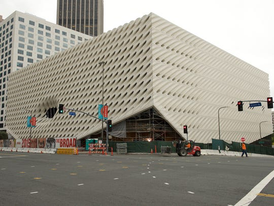 """Scaffolding has been removed from the Los Angeles Broad, revealing the """"veil"""" covering the """"vault"""" below."""