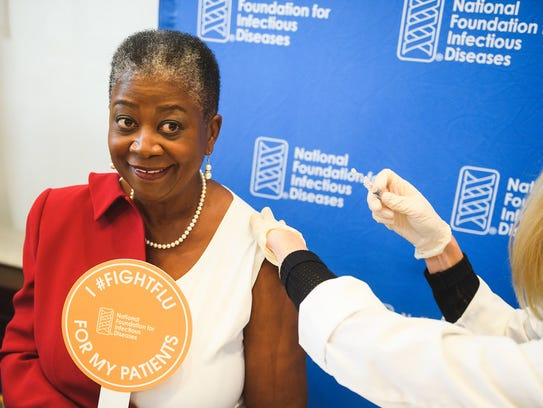 Dr. Patricia N. Whitley-Williams receiving a flu shot