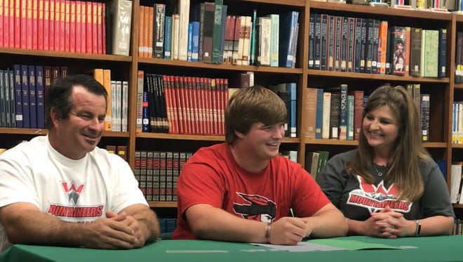 Wall High School's Carson Stephens signs a national letter of intent on Friday, May 18, 2018, in the Wall school library to run track for Western State Colorado University.
