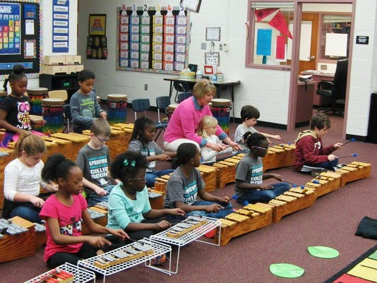Third-graders play Orff instruments in Mary Register's Springwood Elementary