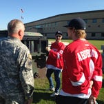 Defenseman Danny DeKeyser, left, and left wing Justin Abdelkader take pictures with soldiers at the Michigan National Guard Joint Forces Headquarters in Lansing on Wednesday during the Detroit Red Wings' sixth annual MI Wings Community Tour.