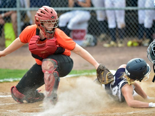Chambersburg's Molly Keefer scores ahead of a tag from Latrobe catcher Morgan SchweizerChambersburg softball battled Latrobe in the PIAA Class 6A softball playoff game Monday, June 5, 2017 at Shippensburg University. The Trojans won 4-2.