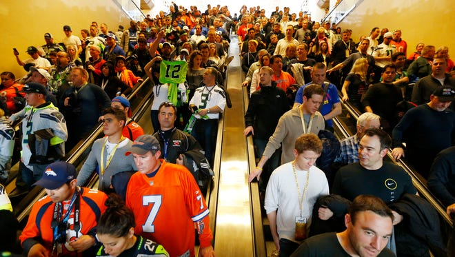 Football fans make their way to trains on Sunday in Secaucus, N.J, even hours after the Seattle Seahawks' 43-8 victory against the Denver Broncos.
