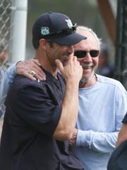 Tigers manager Brad Ausmus, left, talks with former