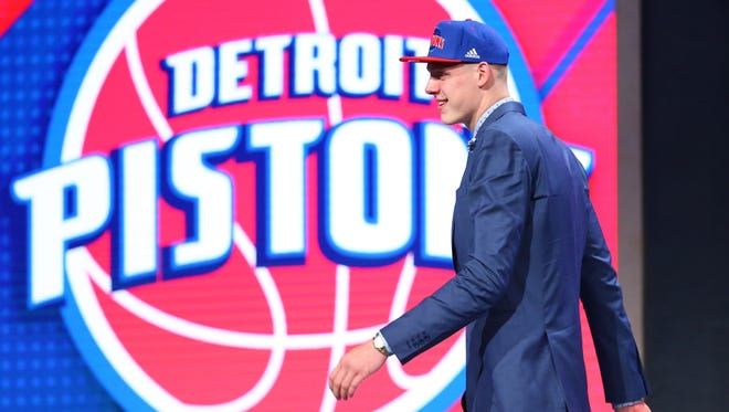 Jun 23, 2016; New York, NY, USA; Henry Ellenson (Marquette) walks off stage after being selected as the number eighteen overall pick to the Detroit Pistons in the first round of the 2016 NBA Draft at Barclays Center.